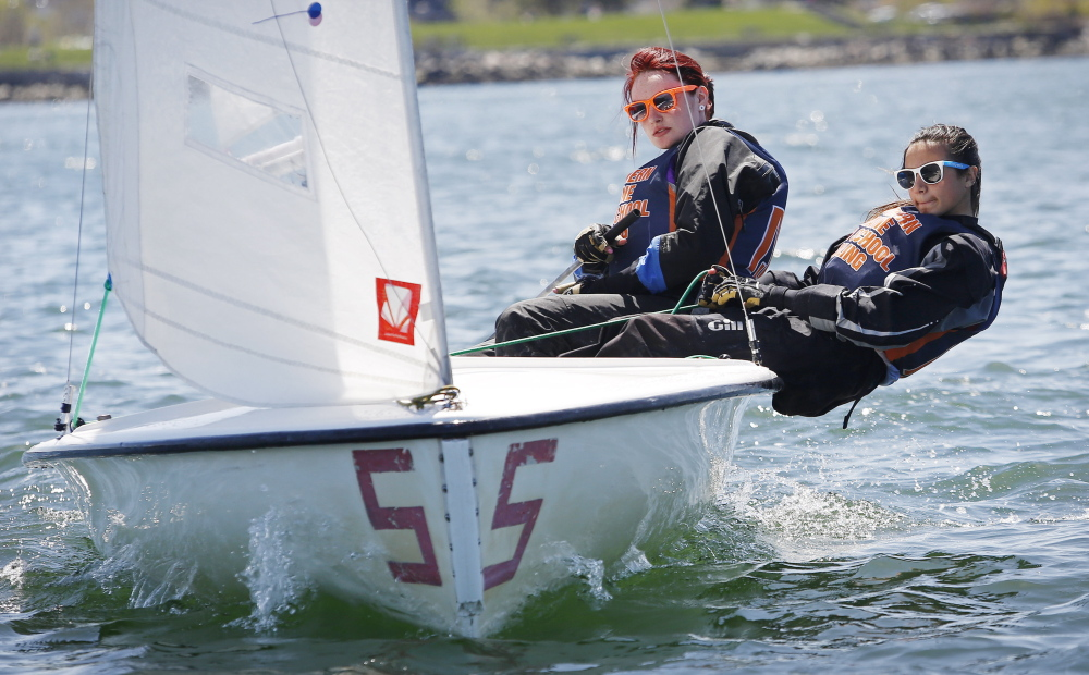 "Waynflete School freshman Kelley Frumer, right, ""hikes out"" to take full advantage of the wind as she and teammate Elizabeth Newberry, a senior at Bonny Eagle High School, compete in Sunday's regatta."