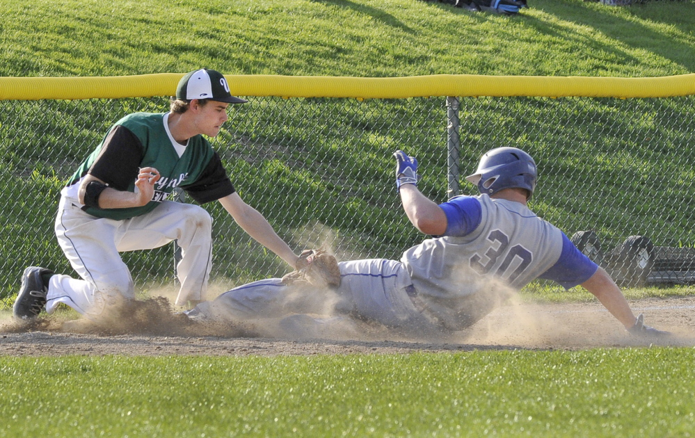 Waynflete's Matt Jarrell makes the tag on Old Orchard's Thomas Fregeau at third.