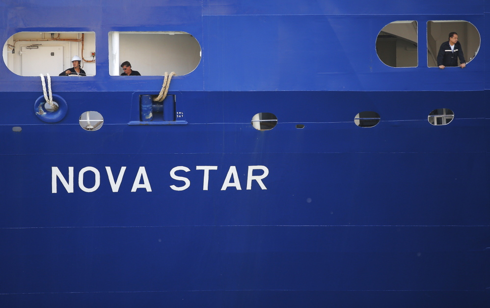 David Boggs, a travel writer for Argo Global, photographs the Nova Star at Black Falcon terminal in Boston on Monday.