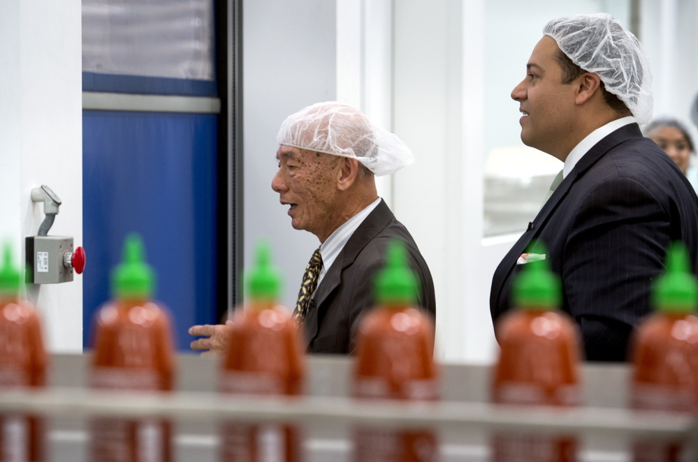Texas state Rep. Jason Villalba, right, tours the Huy Fong Foods plant, maker of Sriracha hot sauce, with founder and CEO David Tran, in Irwindale, Calif., on Monday.