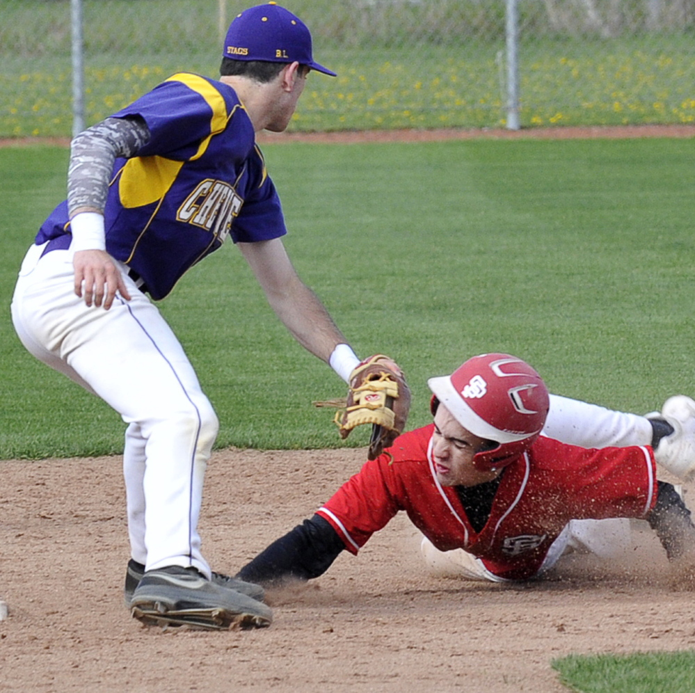Cheverus' Felix del Vecchio puts a tag on South Portland's Robert Graff at second base. The Red Riots went on to take a 2-0 home win Tuesday over the Stags.