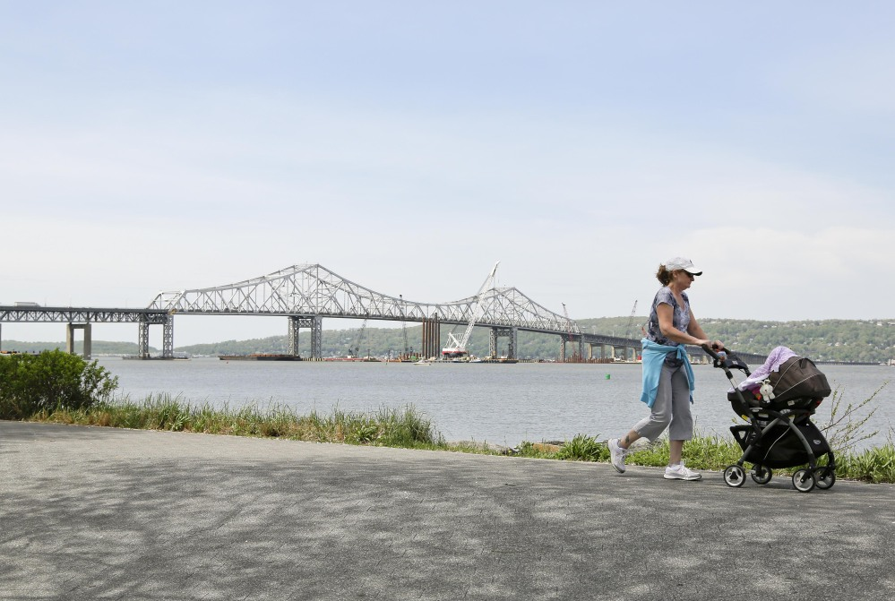 A woman takes a stroll with her child along the Westchester Riverwalk just north of the Tappan Zee Bridge, Tuesday.
