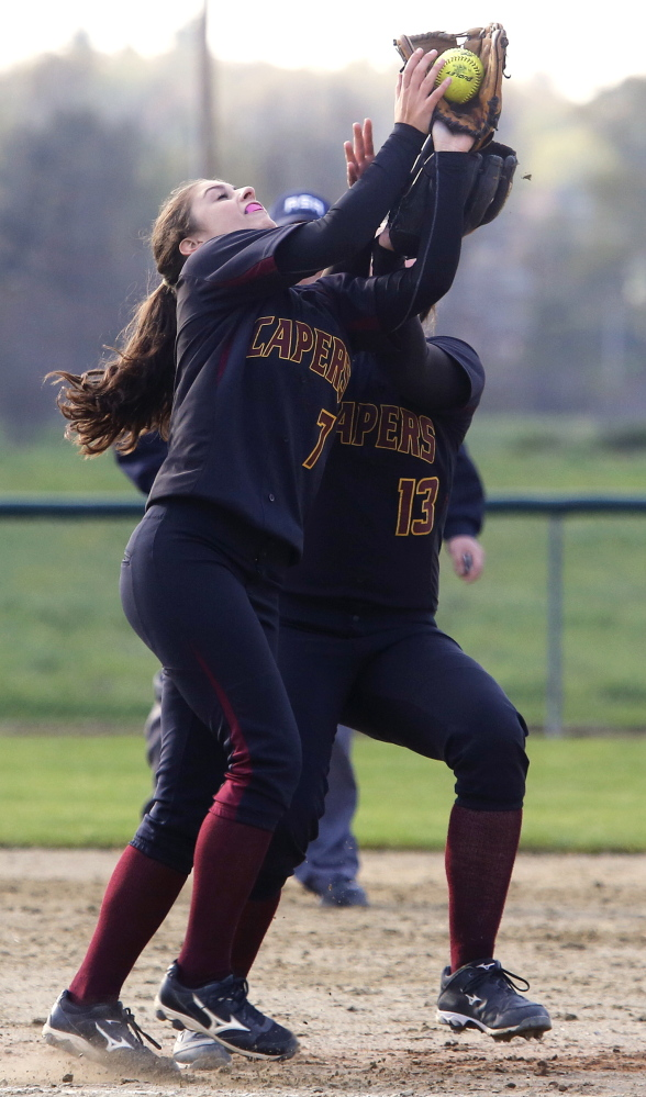 Emma O'Rourke of Cape Elizabeth makes a catch to end the fourth inning Wednesday while avoiding a collision with teammate Ashley Tinsman. The Capers defeated Greely, 12-3.