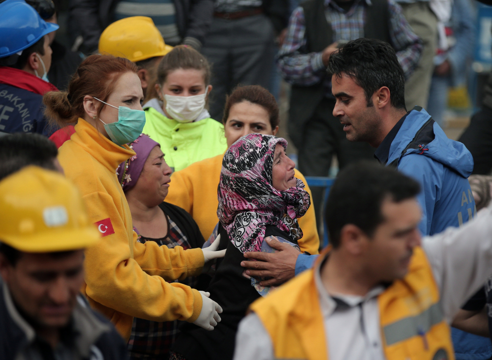 Family members wait outside the mine in Soma, western Turkey, Wednesday as rescuers desperately raced against time to reach more than 200 miners trapped underground after an explosion and fire.
