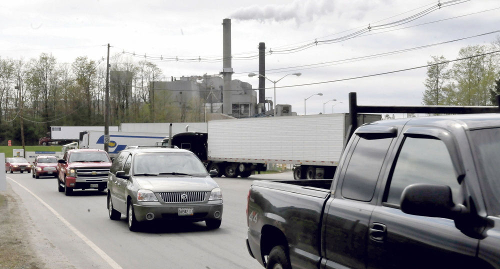 Workers leave the Sappi paper mill in Skowhegan on Wednesday. The parent company has announced a 5 percent reduction in its nationwide workforce.