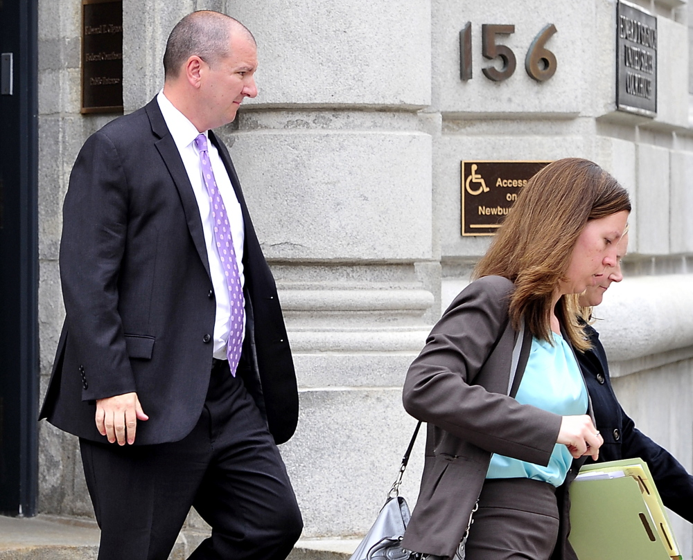 Jeffrey Burnham leaves U.S. District Court in Portland with his attorney, Sarah Churchill, on Thursday after being formally charged with felony theft.