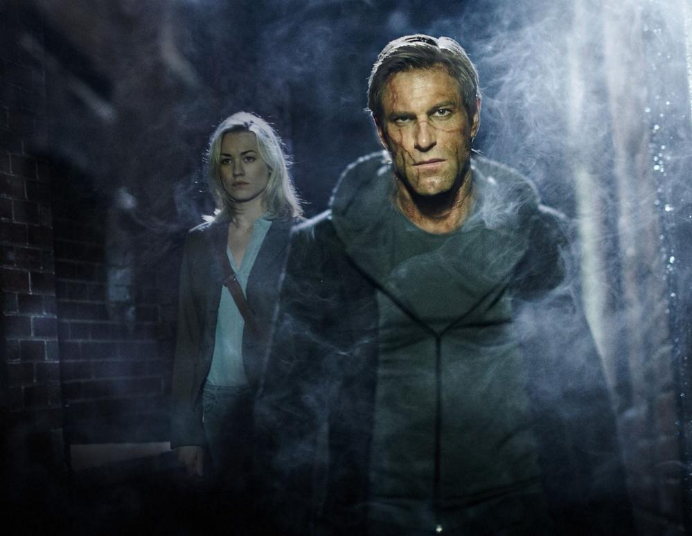 "Yvonne Strahovski and Aaron Eckhart in ""I, Frankenstein"""