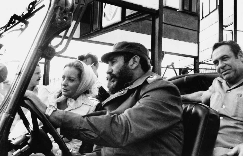 Walters in 1977 being driven by Fidel Castro on a sightseeing tour in Cuba.
