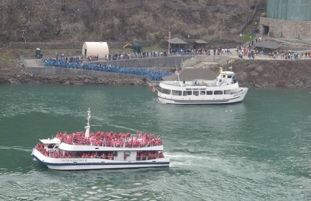 A Hornblower Niagara Cruises Catamaran, foreground, passes near a Maid of the Mist boat in Niagara Gorge last week. The Maid of the Mist Steamboat Co. continues to launch from the American shore but lost its Canadian contract.