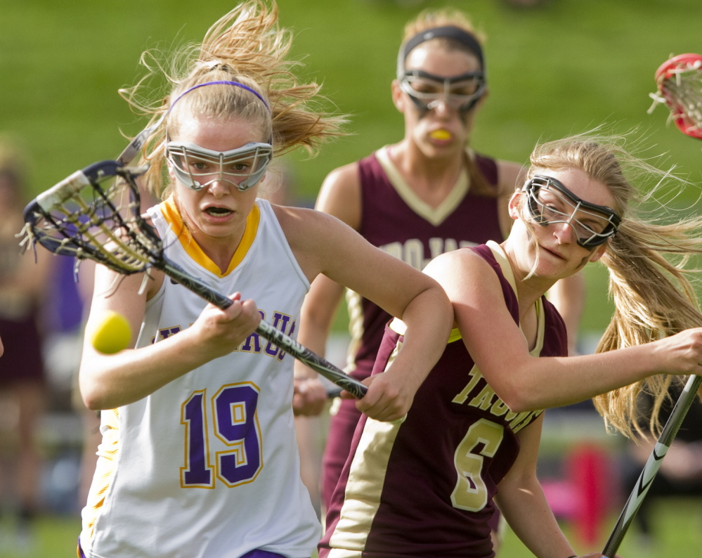 Anne Veroneau of Cheverus chases after the ball with Thornton Academy's Julianna Grondin in Tuesday's girls' lacrosse game at Portland. Cheverus won, 9-6.