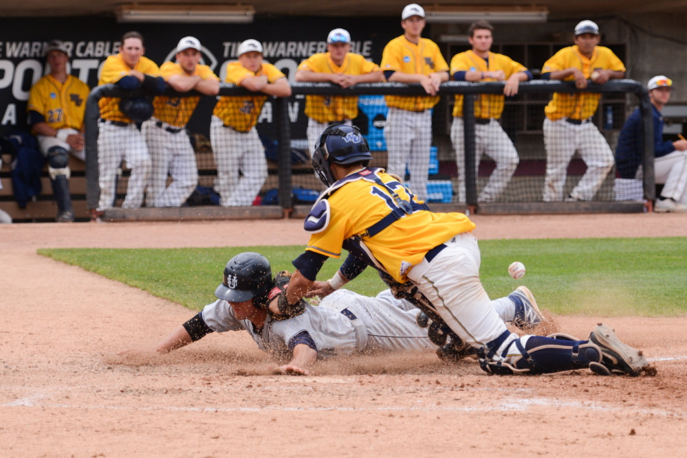 Forrest Chadwick of Gardiner, then a USM junior outfielder, scores in the third game of last year's Division III championships. Over Ed Flaherty's 29 seasons as head coach of the Huskies, the team has been to the NCAA championships eight times, and had 25 players selected as All-Americans, 17 of them from Maine.