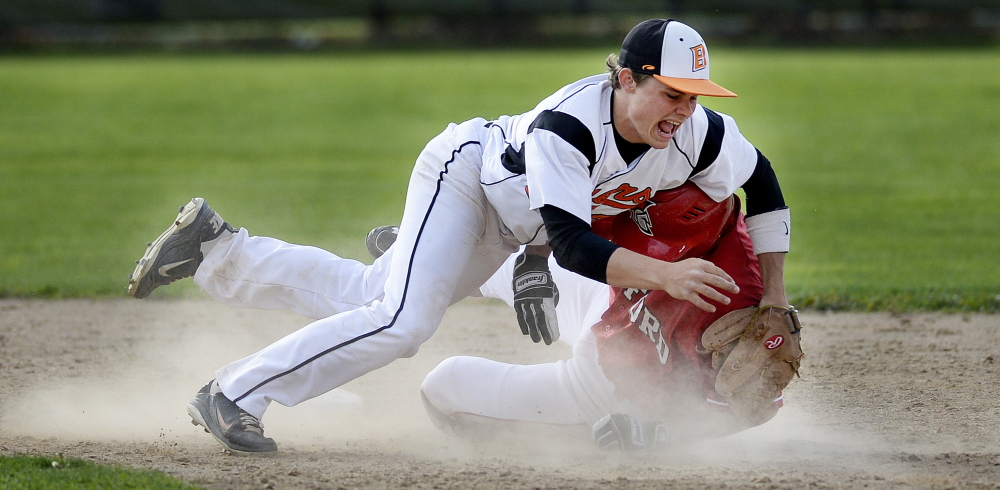 Biddeford's Corey Creeger collides with Sanford's Eddie Michetti during a play at second base Tuesday. Michetti was tagged out on the play.