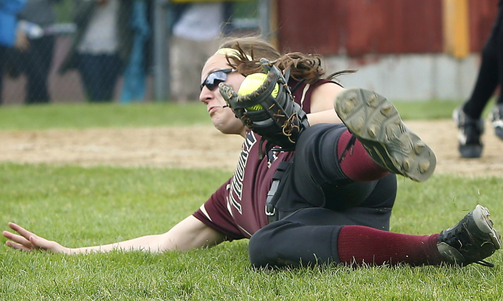 Thornton Academy first baseman Erin Brayden makes a diving catch of a foul popup, one of several strong defensive plays made Saturday by the Trojans in support of pitcher Bailey Tremblay on the way to a 5-0 softball win over Biddeford.