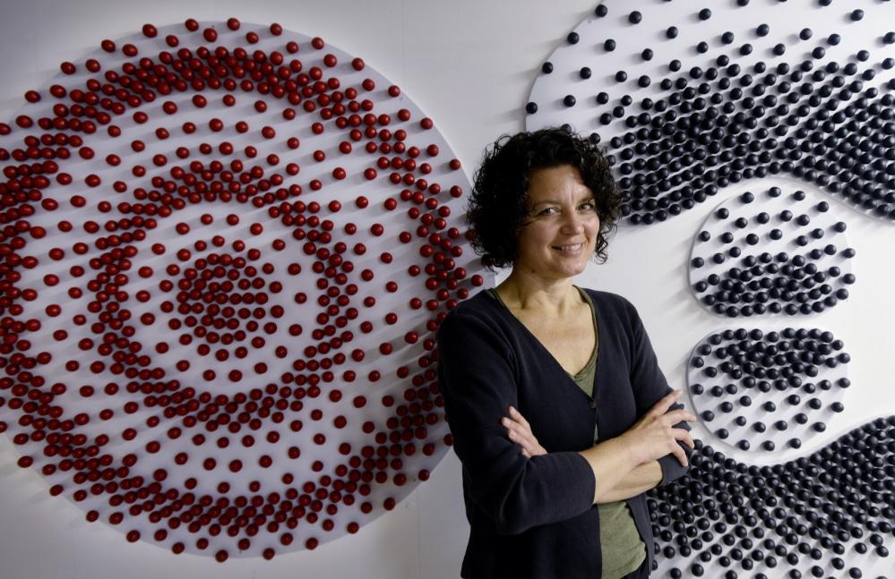 """North Berwick artist Kim Bernard in her studio with her """"Hydrogen Atomic Orbitals"""""""