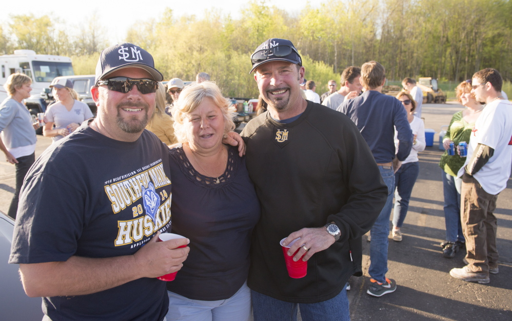 David Verrier, left, Theresa Carey, middle, and Matt Glauser, right, are part of a group of parents who followed the University of Southern Maine baseball team to Appleton, Wis., for the Division III championships.