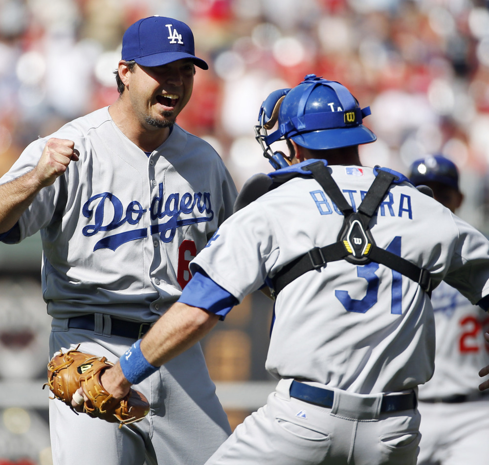 Dodgers pitcher Josh Beckett, left, celebrates with catcher Drew Butera after striking out Chase Utley of the Phillies to finish off a no-hitter Sunday in Philadelphia.