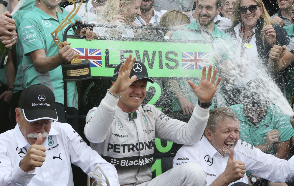 Mercedes driver Nico Rosberg, of Germany, celebrates with his team after winning the Monaco Formula One Grand Prix at the Monaco racetrack, in Monaco, Sunday.