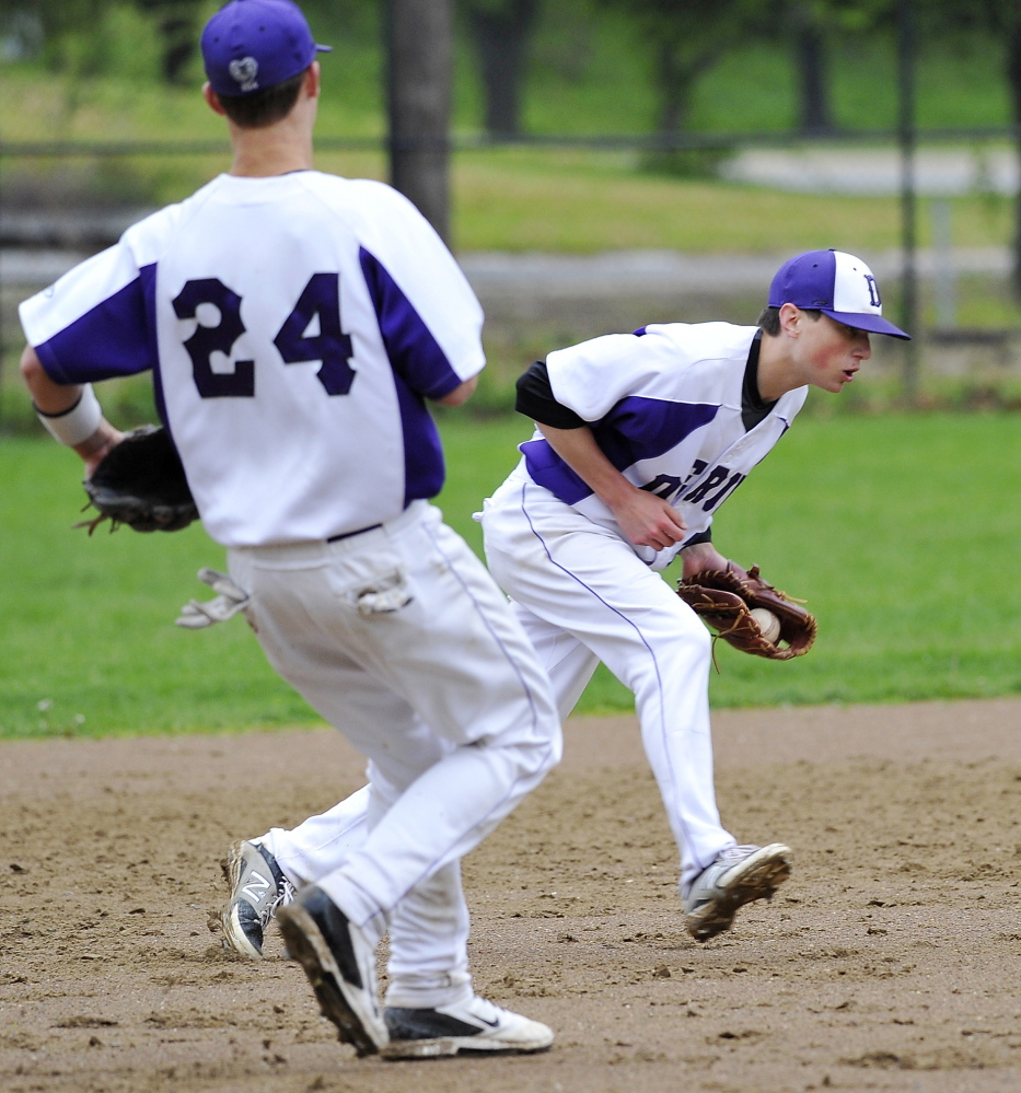 Deering shortstop Nick Bevilacqua fields a grounder before throwing the batter out as third baseman Will Barlock moves in Tuesday. The Rams fell to Portland 10-1 at Deering Oaks.