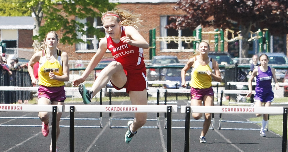Callie O'Brien of South Portland clears the final hurdle on her way to victory in the 300-meter hurdles in the SMAA track and field championships Saturday at Scarborough High. Photos by Jill Brady/Staff Photographer