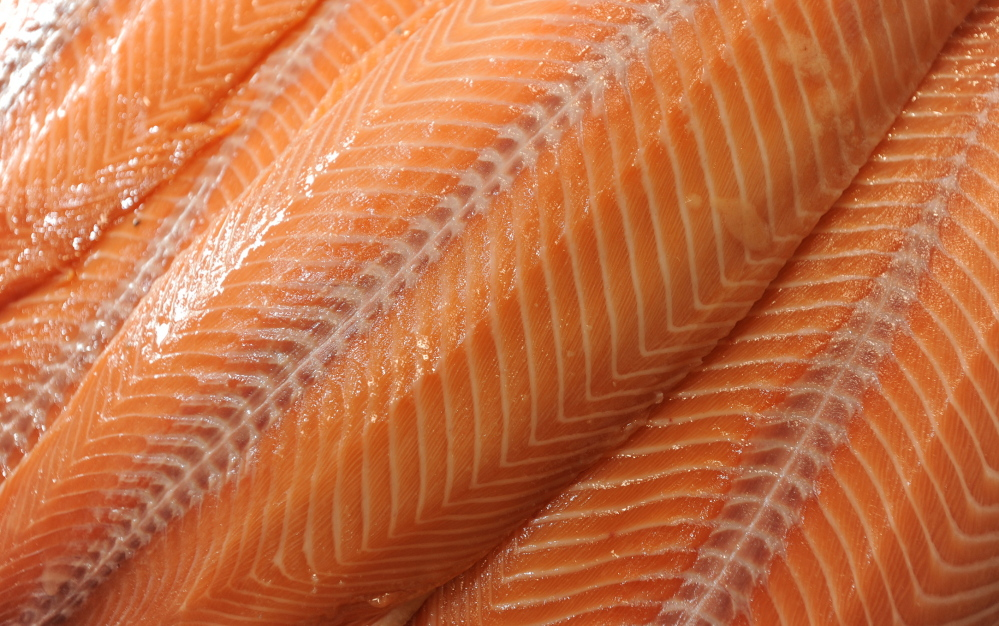 Freshly skinned Sullivan Harbor Farm smoked salmon awaits packaging. Sullivan Harbor Farm is adding an inn, a restaurant and a slew of new products.