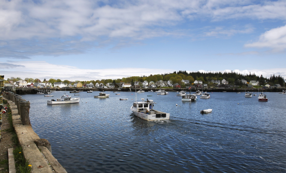 A lobster boat enters Carvers Harbor on Vinalhaven, off Maine's midcoast, last month. The island's year-round residents number around 1,200. During the summer, its population swells to about 4,000.