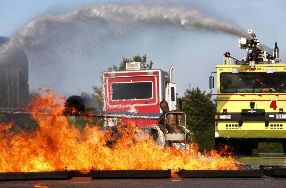 Firefighters Battle Practice Blaze At Portland Jetport ...