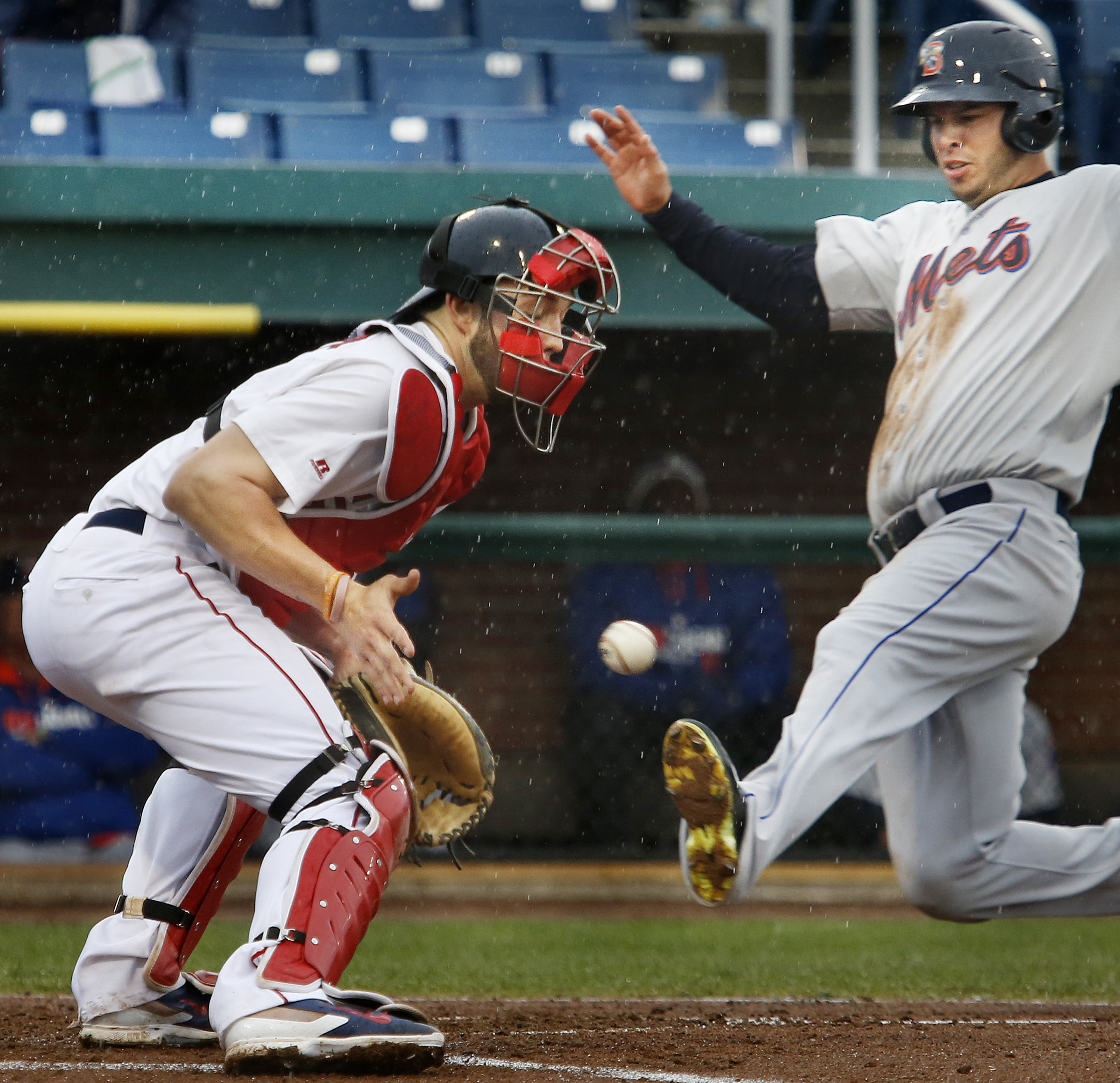 The throw to Blake Swihart of Portland is a little late as Matt Clark of Binghampton comes in to score, Monday, May 19, during the fourth inning at Hadlock Field. Derek Davis/Staff Photographer