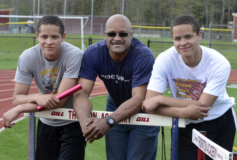Twins Dylan, left, and Andrew Smith are receiving top-notch coaching while competing for the Thornton Academy track team. Their father, Carl Smith, was a superior athlete in high school and at UMaine, and is an assistant at Thornton. John Patriquin/ Staff Photographer