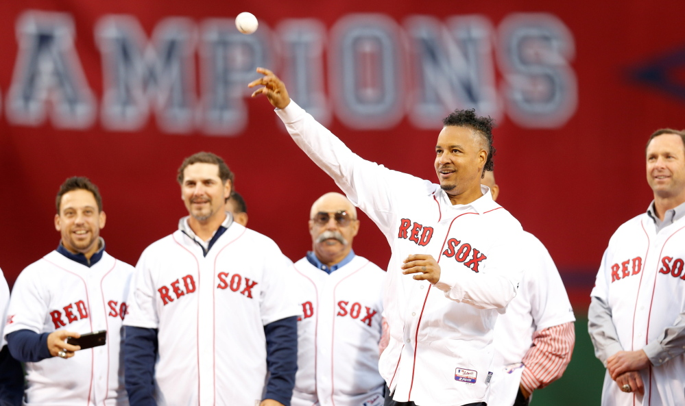 Manny Ramirez – yes, that's a new Mohawk – tosses out the first pitch during the reunion of Boston's 2004 championship team. Reuters photo by Greg M. Cooper/USA TODAY Sports