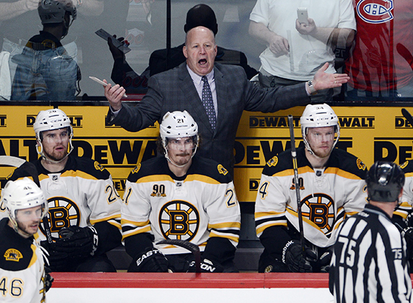 Boston Bruins head coach Claude Julien yells at the referee during the third period of an NHL second round Stanley Cup playoff game on Monday in Montreal.