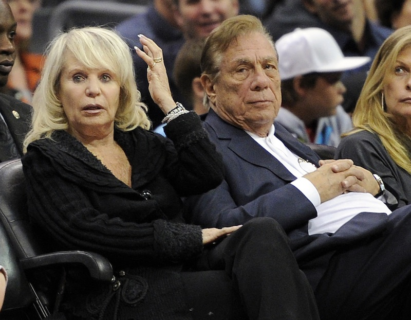 In this Nov. 12, 2010, file photo, Los Angeles Clippers owner Donald T. Sterling, right, sits with his wife Rochelle during the Clippers NBA basketball game against the Detroit Pistons in Los Angeles. An attorney representing the estranged wife of Clippers owner Donald Sterling said Thursday, May 8, 2014, that she will fight to retain her 50 percent ownership stake in the team.