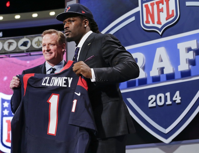 South Carolina defensive end Jadeveon Clowney holds up the jersey for the Houston Texans first pick of the first round of the 2014 NFL Draft with NFL commissioner Roger Goddell on Thursday in New York.