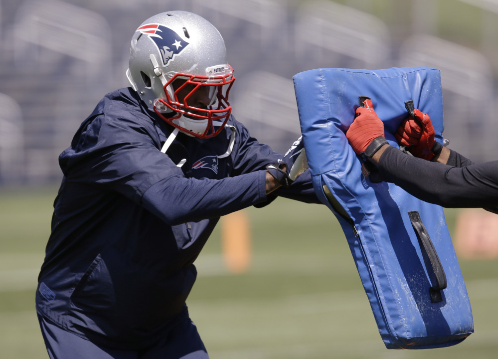 New England Patriots corner back Darrelle Revis (24) works a drill during an organized team activity at the NFL football team's facility Friday, May 30, 2014 in Foxborough, Mass. The Associated Press/Stephan Savoia