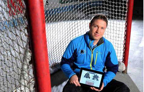 Dan Kerluke, a former UMaine hockey player and coach and the CEO of Double Blue Sports Analytics in Orono, displays Double Blue's app for training hockey goalies.