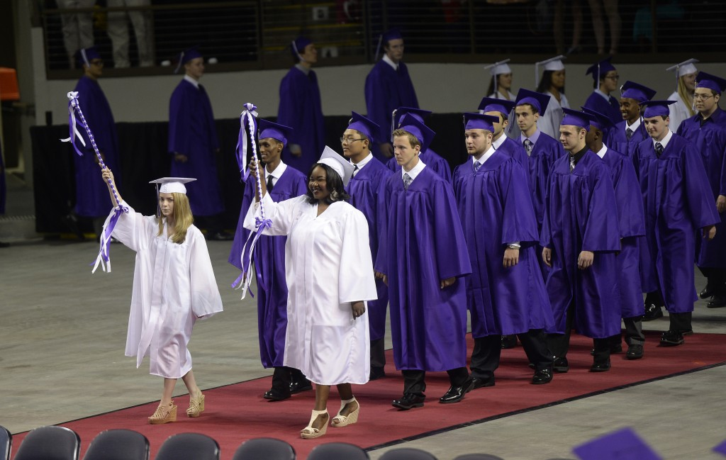 Deering High School seniors  march into the Cumberland County Civic center for graduation .