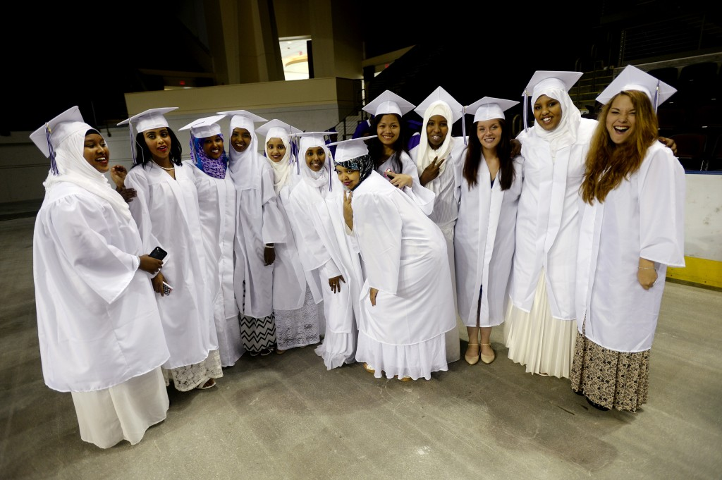 Girls pose together for photographs prior to the Deering graduation.