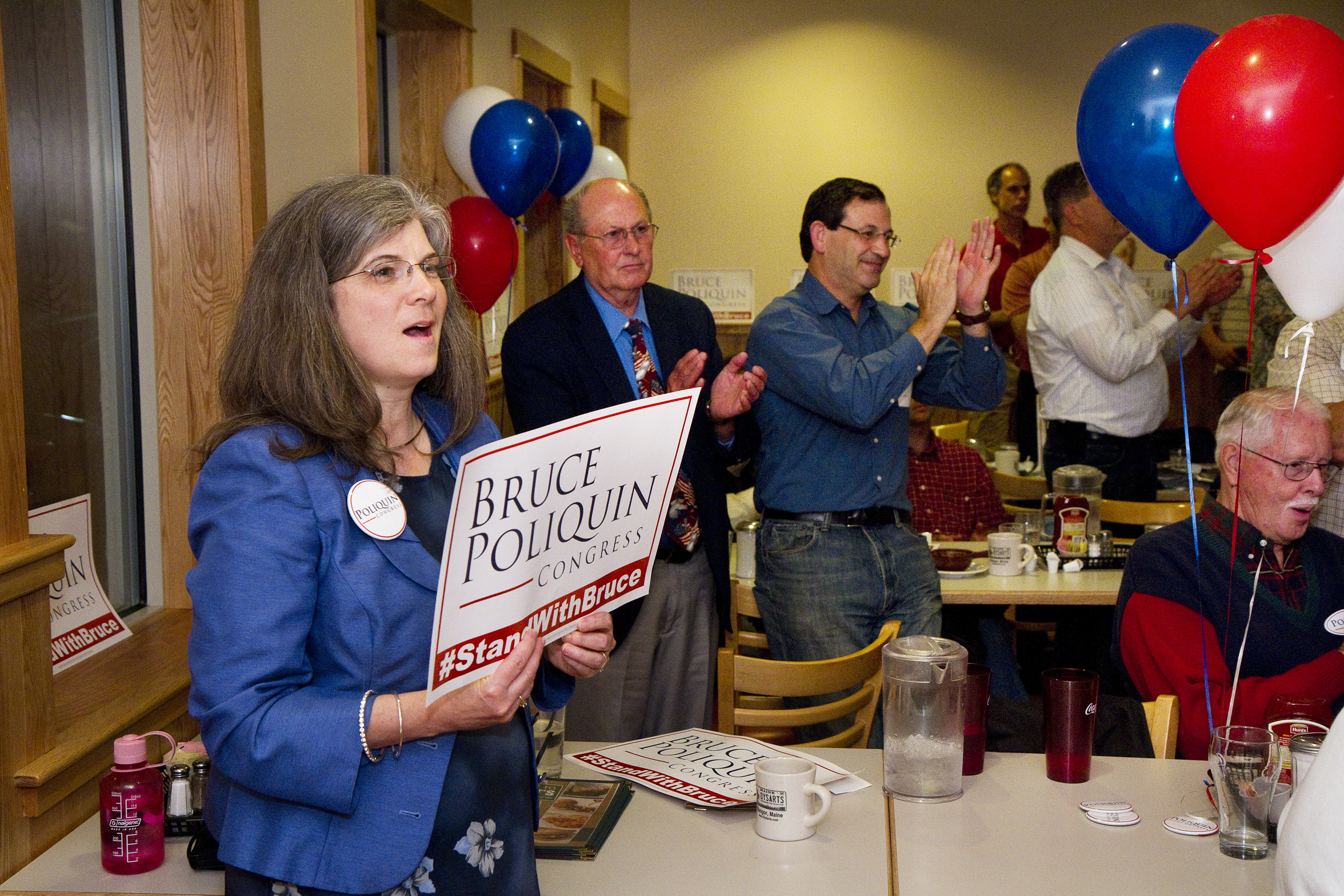Bruce Poliquin supporters, including Joanne Gray of Charlston, left, cheer on their candidate after declaring victory. Carl D. Walsh/Staff Photographer