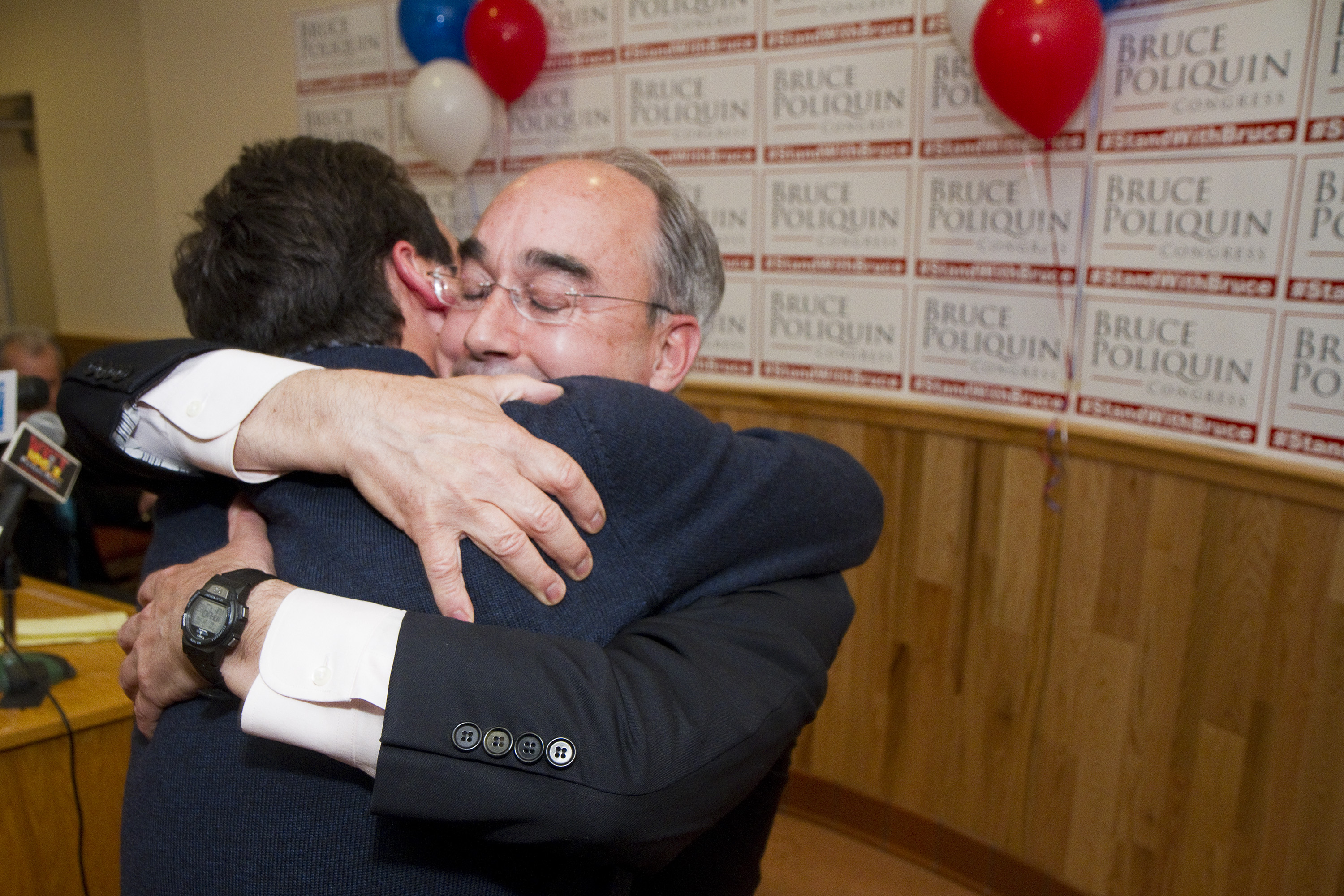 Bruce Poliquin hugs his son Sam after declaring victory in the primary at Dysarts Broadway in Bangor Tuesday.   Carl D. Walsh / Staff Photographer