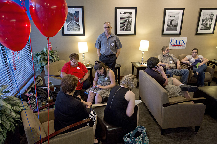 Members of Emily Cain's family wait in a room at the Holiday Inn on Odlin Road in Bangor for results from the primary election. Gabe Souza/Staff Photographer