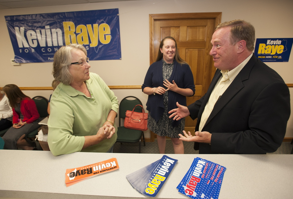 Republican primary candidate Kevin Raye talks with campaign volunteers as they wait for results to come in on the evening of June 10. Kevin Bennett Photo