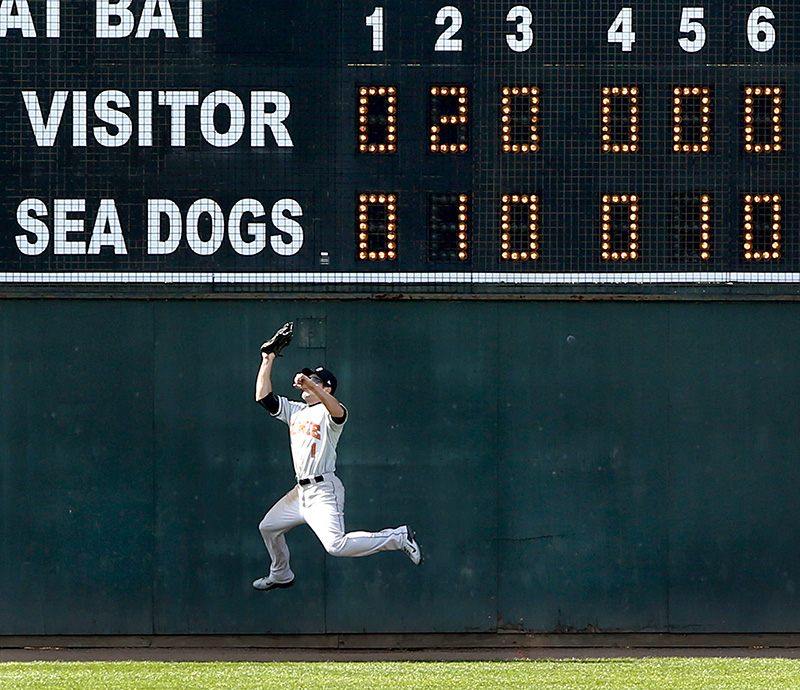Bowie Baysox centerfielder Johnny Ruettiger makes a leaping catch at the wall to keep the score tied in the bottom of the ninth inning at Hadlock Field in Portland on Sunday. Tim Greenway/Staff Photographer