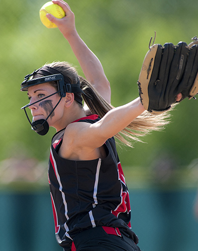 Wells' softball pitcher Lauren Bame (14) delivers a pitch in the fifth inning of their Class B state championship game against the Hermon Hawks at Coffin Field in Brewer, Maine, Saturday. Michael C. York/Special to the Telegram