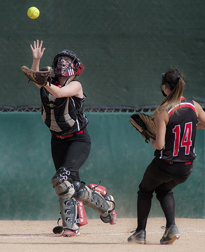 Lauren Bame (14) rushes to cover catcher Meghan Young on a pop up in the third inning of their Class B state championship game against the Hermon Hawks at Coffin Field in Brewer, Maine, Saturday. Michael C. York/Special to the Telegram