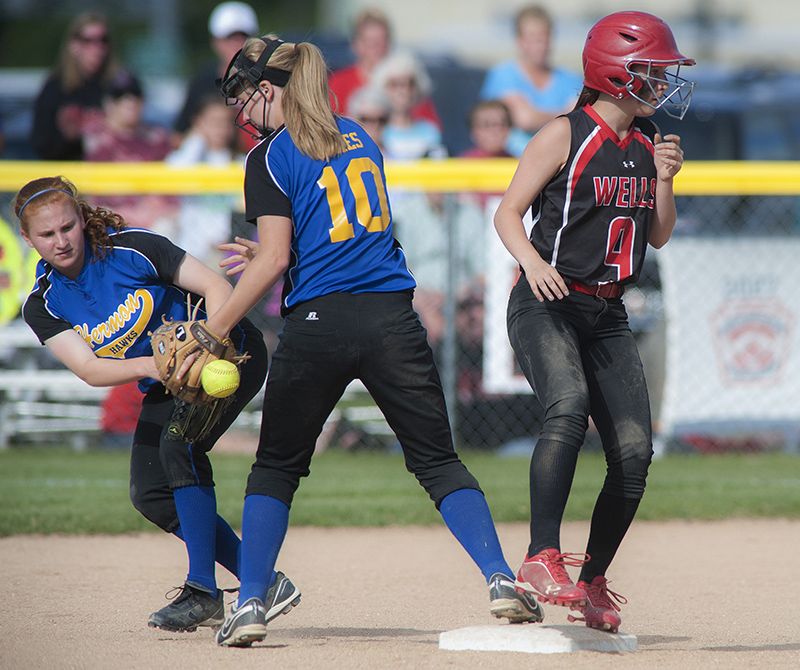 Wells' second baseman Allyson O'Brien takes second base in the sixth inning as Hermon second baseman Claire Petersen, left, and shortstop Alessa Oakes (10) lose the handle on the ball behind second base in their state  Class B state championship game  at Coffin Field in Brewer, Maine, Saturday. Michael C. York/Special to the Telegram