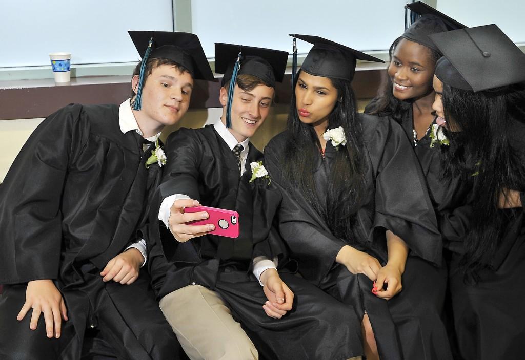 Kiernan Cummings takes a selfie with his iPhone before Casco Bay High School's graduation.