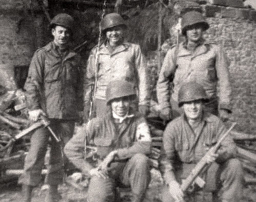 Photo courtesy Charles Shay A 1944 photo from his scrapbook shows Charles Norman Shay, bottom left, with some Army buddies in Germany several months after the D-Day invasion. The details of the bloody invasion – as many as 10,000 Allies were killed or wounded – are still vivid in Shay's mind.