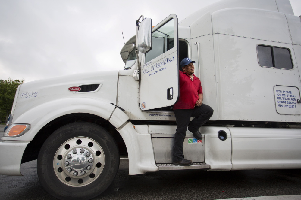 Truck driver Cesar Solis, 42, stops Thursday at the Maine Turnpike service plaza in Kennebunk. He said his pay fell when new driver rest rules took effect last summer, but he understands the need for safety and he doesn't push the limits. Gabe Souza/Staff Photographer