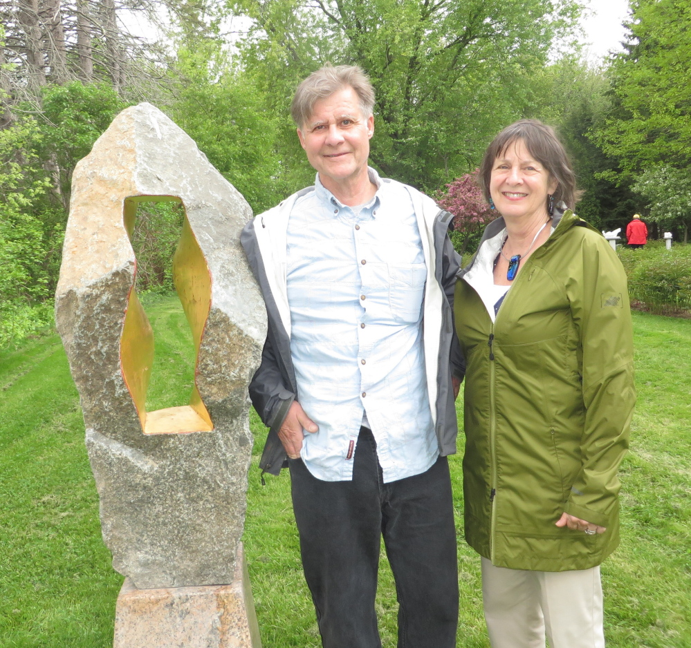 "Sculptor Gary Haven Smith with his wife, Susan Pratt-Smith, beside his piece ""Kennen,"" an Old English word for ""view,"" at Gilsland Farm."