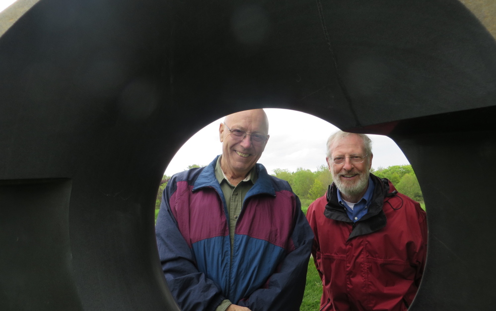 "Mike Iveson of Buckfield and Al Daniels of Norway enjoy the sculpture exhibit at Gilsland Farm's opening reception for ""A Celebration of Art and Nature."" The installation by art dealer June LaCombe is in place through September. Photos by Amy Paradysz"
