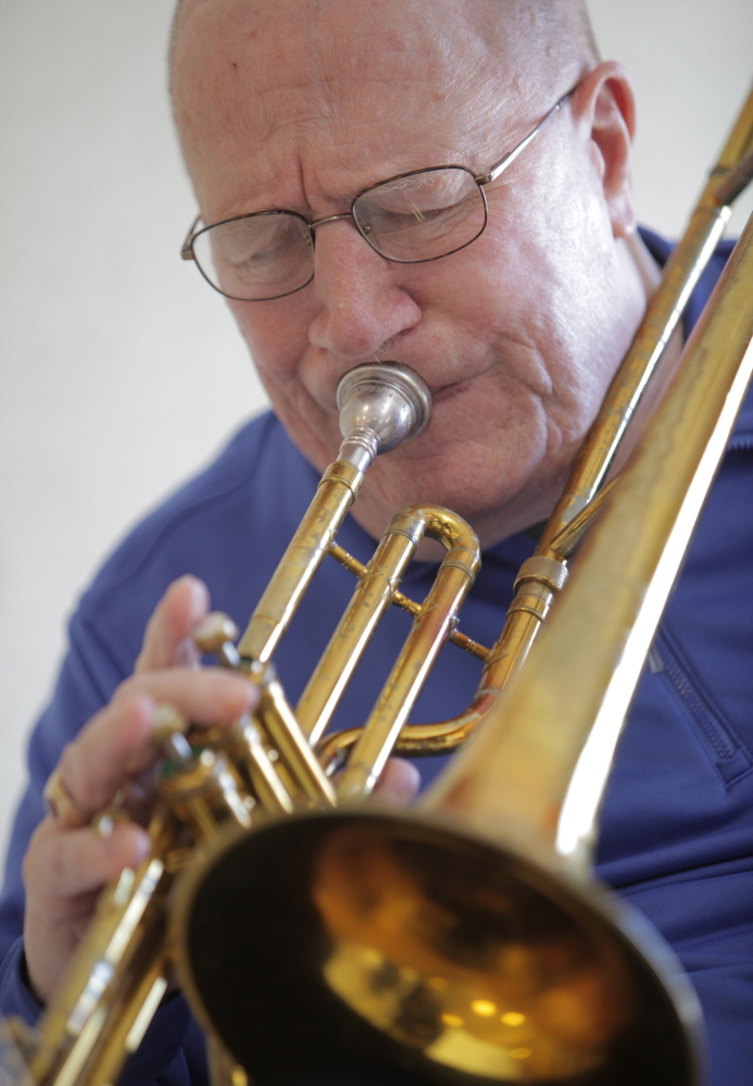 Photos by Amelia Kunhardt/Staff Photographer Trombonist Don Doane, who grew up in South Portland, practices at the Maine Veterans' Home in Scarborough. Doane, 82, suffered a stroke in 2001 that paralyzed his left side, and plays a valve trombone because he can no longer hold a slide trombone.